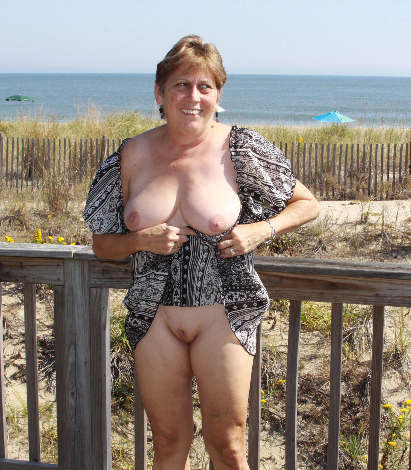 Mature naked woman in public